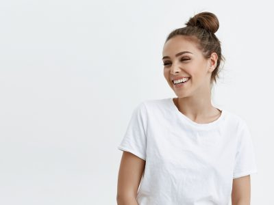 woman in white tee shirt smiling