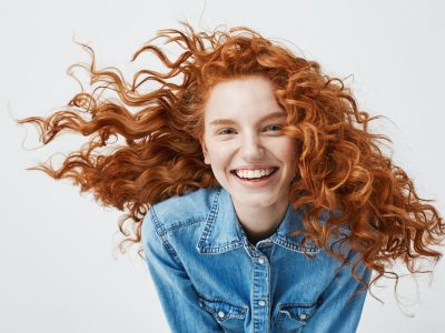 woman with wild curly red hair